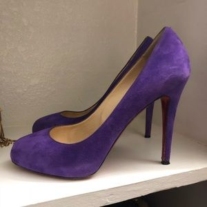 Christian Louboutin purple pumps